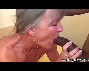 Grey haired granny enjoys large dark dick