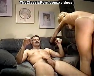 Nina hartley, mike horner in sassy blond is drilled in a retro xxx movie scene
