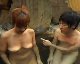 Asian wife satisfying hubiie with blowjob in pool
