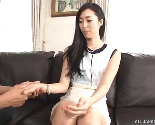 Luscious Asian lady pleasuring hubby on the couch