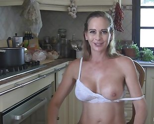 Juggy housewife strips and masturbates in the kitchen