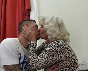 Perverted granny in stockings and high heels shagged on the couch