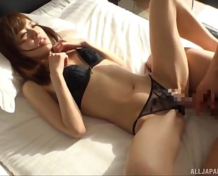 Asian damsel in black stockings gets deeply fucked and facialized