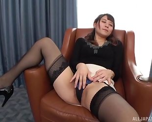 Insatiable Japanese lady with small tits fucked on a chair