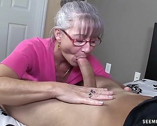 Horny granny sucks a young cock