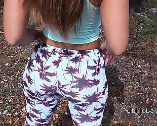 Latina hottie in legging shaking ass in public