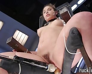 Babe restrained to chair for love tunnel toying