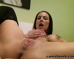 Busty playgirl fucking a sextoy on web camera